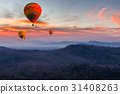 Colorful hot air balloons flying over mountain 31408263