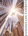 plane over skyskrapers 31408450