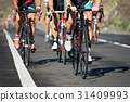 Cycling competition,cyclist athletes riding a race 31409993