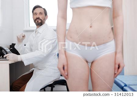 Capable successful plastic surgeon providing 31412013