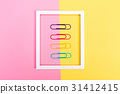 Big paper clips on a vibrant background 31412415