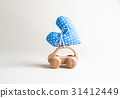 Toy car carrying a heart 31412449