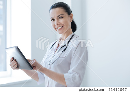 Pleasant medic using digital gadget in the clinic 31412847
