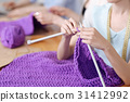 Delicate beautiful female hands knitting 31412992