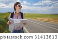 girl holding map with backpack in the road and Tuscany backgrou 31413613
