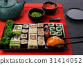 Eating sushi and rolls in japanese restaurant 31414052