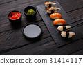 Set of sushi on black wood background, closeup 31414117