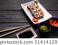 Set of sushi rolls on black wood background 31414120