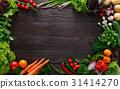 Frame of fresh vegetables on wooden background 31414270