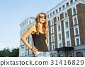 Sunny lifestyle fashion portrait of young stylish 31416829
