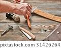 Man stropping straight razor 31426264