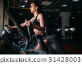 Female athlete exercise on treadmill in sport gym 31428003