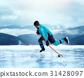 Professional hockey player exercise on frozen lake 31428097