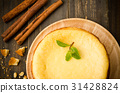 New York cheese cake on wooden background 31428824
