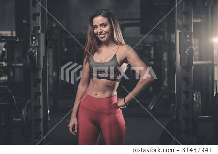 Caucasian sexy fitness female model in gym close up abs. 31432941