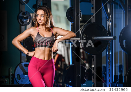 Girl execute exercise with barbell 31432966