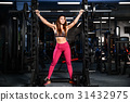 Girl execute exercise with barbell 31432975