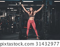 Girl execute exercise with barbell 31432977