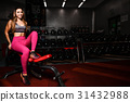 Girl execute exercise with dumbbells . 31432988