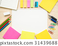 Table top view of stationery items and paper 31439688