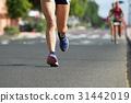 Marathon running race, people feet on city road 31442019