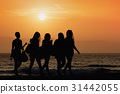 Silhouette five women walking along the waterfront 31442055