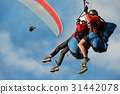 Two paraglider tandem fly against the blue sky 31442078