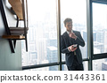 Young businessman is using smartphone at office 31443361