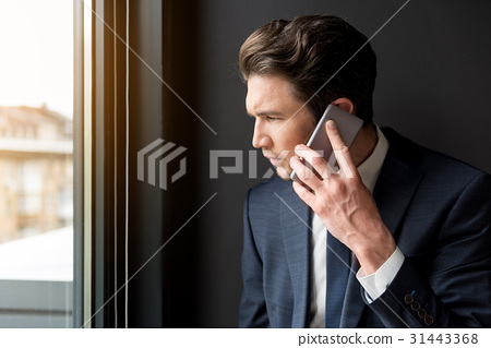Frustrated businessman is having communication on 31443368