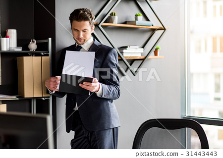 Pleasant professional employee is working in 31443443