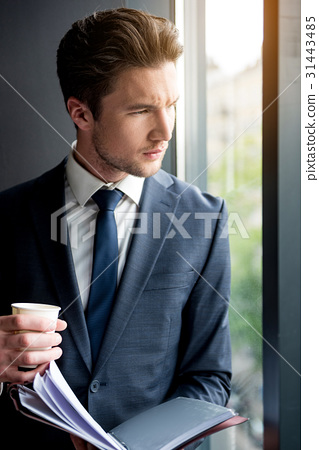 Pensive elegant man in suit is resting with coffee 31443485