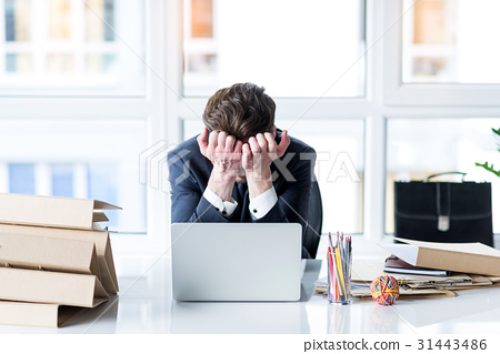 Young employee is tired of working on laptop 31443486
