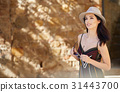 attractive woman tourist  with hat in old european town 31443700