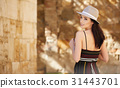 attractive woman tourist  with hat in old european town 31443701