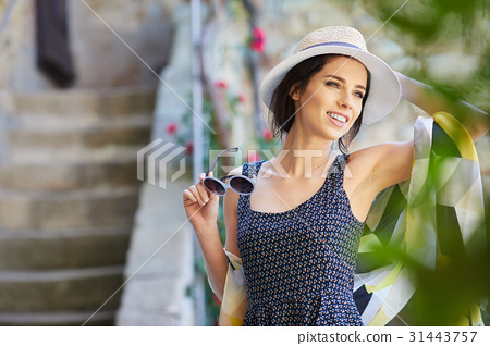 attractive woman tourist  with hat in old european town 31443757