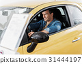 Cheerful male driving new automobile 31444197