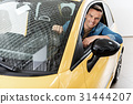 Joyful man sitting in modern automobile 31444207