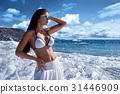 beautiful girl  in white bikini at seaside 31446909