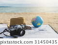 Camera, Hat and sunglasses on the beach 31450435