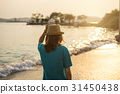 Young woman traveler walking on the beach 31450438