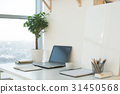 Side view picture of studio workplace with blank 31450568