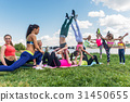Group of fit women doing acrobatics trick outdoors 31450655