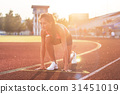 Woman in starting position ready for running in 31451019