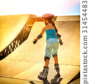 Girl riding on roller skates in skatepark. Backlit 31454483