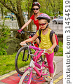 Family bike ride. Family wearing bicycle helmet 31454519
