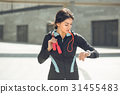 Young woman active exercise workout on street 31455483