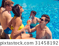 Group of cheerful couples drinking cocktails in 31458192