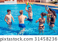 Group of cheerful couples friends playing water 31458236