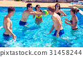 Group of cheerful couples friends playing water 31458244