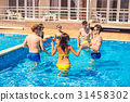 Group of cheerful couples friends playing water 31458302